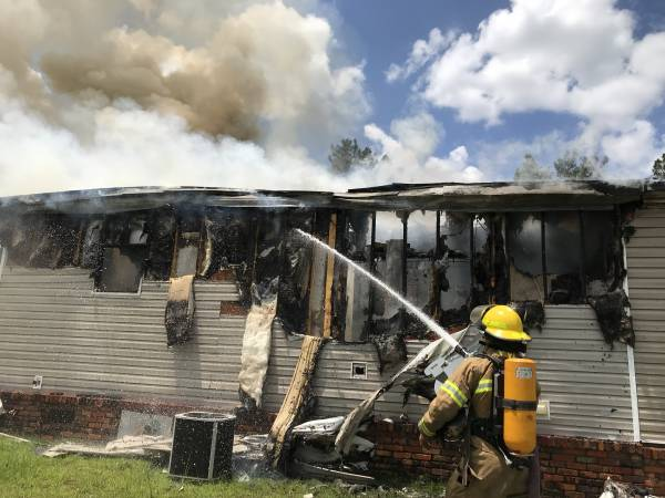 UPDATED @7:47 PM With Scene Pictures.   1:14 PM....  Fire Destroys Home in Lucy