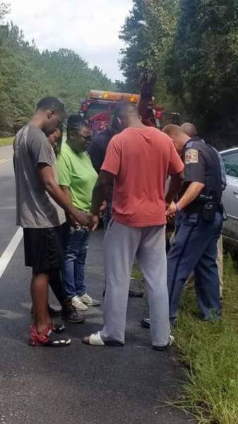 Trooper Prays with Family