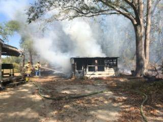 11:18 AM.. Outdoor Fire Turned Structure (Shed) Fire