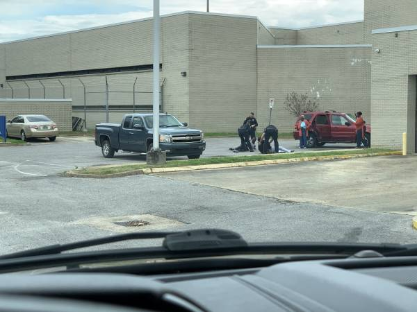10:39 PM. UPDATED WITH PICTURES.  Fight In The Parking Lot of Dothan Police Docket
