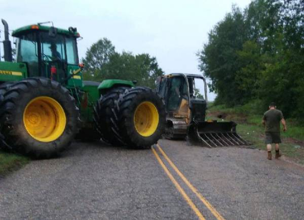 6:11 PM.. Bulldozer Over Turns on County 33