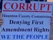 Why The Men Were Walking The Sidewalk and Why Houston County Purchased The Six Story Building