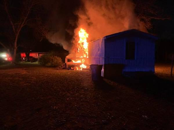 5:21 AM.   Working Structure Fire at Weeks Trailer Park