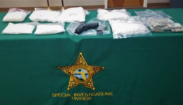 BCSO ARRESTS TWO, SEIZES NEARLY 12 POUNDS METH, CASH, AND A FIREARM