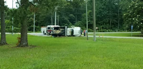 10:20 AM... Dump Truck Overturns at John D Odom and West Main