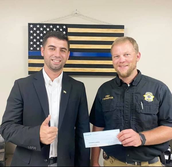 Commissioner Spivey Dedication Check to Slocomb Police and Geneva County